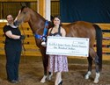 Champion Rodeo Road, shown by Jennifer Tosch, for owners David and Olivia Stone